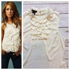 """Ivory ruffle top Gorgeous ivory sleeveless top with front ruffles and single back button. Semi- sheer, front and back darts create shape. Longer length covers waistband. Size M; 18.5"""" chest and 24"""" total length.  Recently dry-cleared, excellent condition. Tops"""