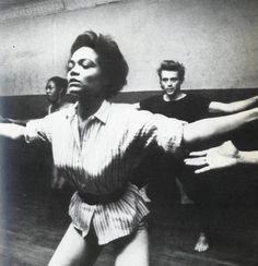 Eartha Kitt teaching a dance class with James Dean in the background