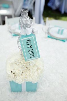 """For a Tiffany inspired baby shower, large """"Baby & Co"""" tags."""