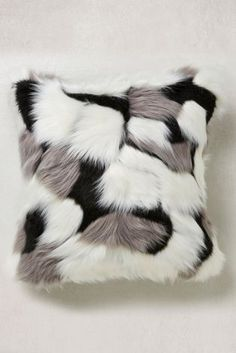Cute and cosy faux fur cushion to throw on her bed or sofa