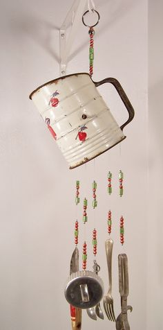 I'm pinning this because of the flour sifter.  My granny had one just like it. Nice windchime though..I love it...