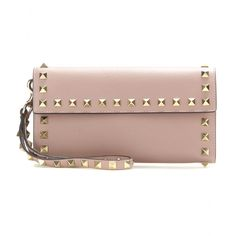 Valentino - Rockstud leather wallet - Clutch a symbol of luxury with this Valentino 'Rockstud' wallet. The leather style is perfect for keeping your monetary essentials in check, and will even serve as an evening accessory, featuring a detachable wrist strap. The flap-over design is super-sleek, while signature stud detailing locks in the iconic status. seen @ www.mytheresa.com