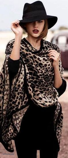 Leopard print cape and Fedora