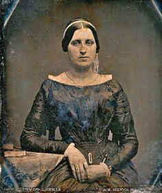 1840s daguerreotype, made in New York City--notice all the bling (hair ornament, necklace, buckle, wrist ornament, at least three rings), plus lace, plus fringe. plus buttons... and what a dress!