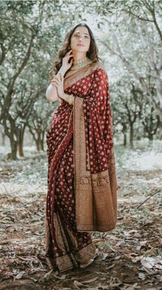 Buy Indian Designer Tamannaah Bhatia's Burgundy Embroidered Paisley Saree with Unstitched Blouse Online You are in the right place about shirt Blouse Here we offer you the most beautiful pictures abou Indian Bridal Wear, Indian Wedding Outfits, Indian Outfits, Moda Indiana, Sari Dress, Stylish Sarees, Bridal Blouse Designs, Saree Look, Indian Sarees