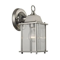 Upgrade your interior and exterior light fixtures with the Thomas Lighting 1 Light Outdoor Wall Sconce In Brushed Nickel And Clear Glass. Thomas offers a variety of styles from traditional to modern contemporary for bathrooms, living areas and b Outdoor Wall Sconce, Outdoor Lighting, Outdoor Walls, Thomas Lighting, Exterior Lighting, Wall Sconces, Wall Sconce Shade, Titan Lighting, Outdoor Sconces