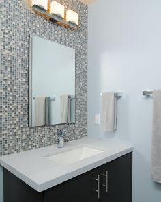 Glass tiled wall behind vanity