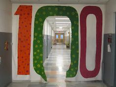 100th day on sheet in front of a hallway-- such a neat idea for the 100th day!!