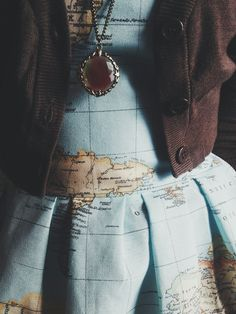 map dress and necklace traveler