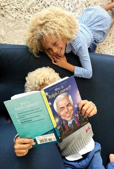"Our friends Stella and Blaise taking in the story of Ralph Lauren's remarkable life and career in ""Who Is Ralph Lauren?,"" the latest edition in Penguin Kids' beloved biography series."