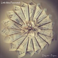 Little Miss Fascinated: Antique Sheet Music Wreath Tutorial..  http://littlemissfascinated.blogspot.com/2013/01/antique-sheet-music-wreath-tutorial.html