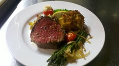 Filet and crabcake, finished with peppercorns and served with aspargus, sitting on a bed of our Chimayan rice