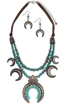 Turquoise Bead Squash blossom Necklace set - Bohemian turquoise bead Squash blossom necklace set with brown leather accent detail! Stunning and unique statement piece. You will truly treasure this timeless boho classic and it's every exquisite detail! Comes with Silver squash blossom Earrings. - On Sale for $28.00 (was $59.00)