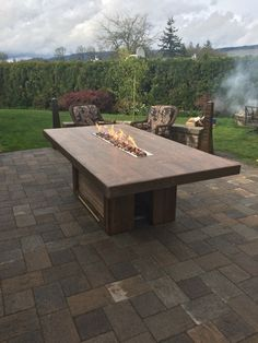Outdoor dining table.  This is  8'x4', and has a 4' fire trough.  The top is made of porcelain floor tiles that look like wood.