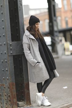 Natalia Cabezas looks sleek and cool in this winter outfit, which consists of leather leggings and fresh white Adidas sneakers. Throw in a beanie and matching scarf for those cold mornings! Coat: Asos, Sweater: Oak+Fort, Sneakers: Adidas Originals.