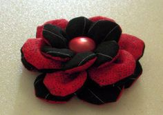 Two tone fabric flower for embellishment.