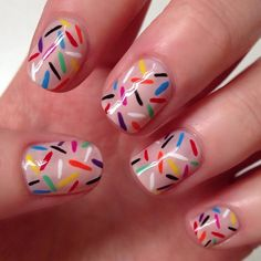 Adorable sprinkle nails. I would probable paint a donut on one nail to go with them too