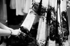 Backstage at the LUBLU Kira Plastinina SS14 fashion show. Steaming garden print skirt.