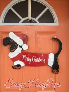 Dachshund Door Hanger, Christmas Door Hanger, Christmas Gift, Christmas Wreath, Christmas Decor, Christmas Sign, Dachshund, Dachshund Gift, Aint He the Cutest!! ************************************************************ Hand cut wood measures approximately 23 x 14 x 1/4. Hand