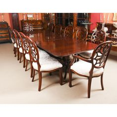 A high quality dining set comprising an antique flame mahogany Regency Revival triple pillar dining table and a bespoke set of 12 dining chairs. Buy Dining Table, Antique Dining Chairs, Mahogany Dining Table, Pedestal Dining Table, Extendable Dining Table, Dining Table Chairs, Side Chairs, Dining Set, Mahogany Furniture