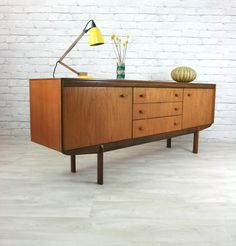 A beautifully designed & crafted 1960s Teak sideboard manufactured by White & Newton of Portsmouth. –Excellent restored conditionA scarcely seen model featuring contrasting teak & afromosia timbers, elegantly carved handles, three good sized drawers with cutlery drawer, two large shelved cupboards and solid afromosia legs. The teak has a lovely vintage golden patina that only age can achieve. Dimensions:W:193cm H:73cm D:43cmA very desirable piece, in excellent resto...