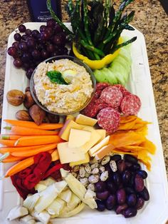 Since I couldn't find any good Charcuterie platters I decided to make my own. Homemade Hummus, crisp al dente asparagus, jicama, artichoke hearts, roasted red peppers, cucumbers, kalamata olives, Gouda, salami, honey sesame almonds, dried mango and figs! Wow who wouldn't want to serve guests this? Easy and what a presentation