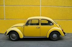 Vintage yellow Volkswagen Bug. My first car was a blue with rust 1969 Volkswagen bug. Man I loved that car!