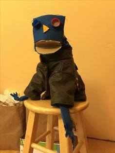 My first puppet! Hand and rod puppet, made with cardboard, fabric, and a whole lot of hot glue. Jacket is a faux leather dog jacket.