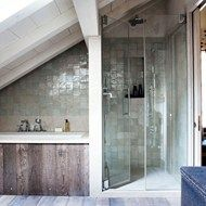 Wood and sea-green tile bathroom