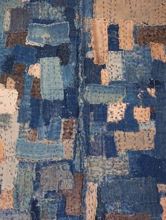 The inside of this coat, shown here,  is like a mosaic with its tessellated surface.   This is an extremely beautiful boro noragi.