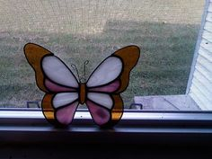 Small stained glass butterfly suncatcher. $12.00, via Etsy.