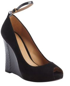 $209, Black Suede Wedge Pumps: AERIN Rin Black Suede And Sakeskin Peep Toe Wedge Pumps. Sold by Bluefly. Click for more info: https://lookastic.com/women/shop_items/106228/redirect