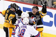 Penguins power past the Rangers:   Patric Hornqvist, right rear, of the Penguins celebrates his second goal of the night during Game 1 of their first-round playoffs series against the New York Rangers on April 13 in Pittsburgh. Hornqvist had a hat trick in the Penguins' 5-2 win.   -       © Gene J. Puskar/AP