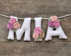 Felt name banner Pastel flowers nursery decor personalized gift baby felt letters baby name garland made to order baby room decor Felt Diy, Handmade Felt, Felt Crafts, Fabric Crafts, Felt Name Banner, Felt Letters, Pastel Flowers, Felt Flowers, Baby Room Decor