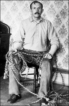 Tom Horn in 1903 while imprisoned awaiting execution in Cheyenne, Wyoming.  Here he is with the rope he was making for his own gallows.