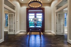 Mocha Mahogany Pediment Entry and RL Roark Edison chandelier.