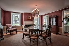 24 Main St., Westford, MA — Grasscloth wall covering, chair rails and wallpaper distinguish the dining room in this brick-end Federal Colonial home in the heart of Westford.