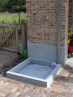 Outdoor wash station. Good idea for pets, large objects, dirty children and men!! Great backyard idea!