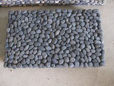 How to Make a DIY River Rock Doormat – The Owner-Builder Network