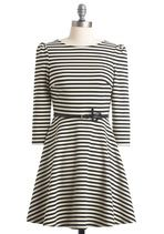 Cotton jersey striped dress. Perfect with flats in warmer weather. Layer with a sweater and wear with thick tights, long socks and boots in the winter.