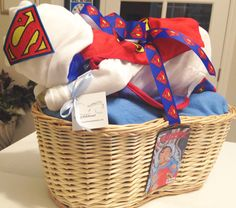 Custom Superman Diaper Baby Basket! Perfect for a baby shower gift, a baby shower centerpiece, a hospital gift or nursery decor.  Want to customize or personalize your gift? Ask us how!  Now offering hospital delivery! www.everythingandthebaby.com