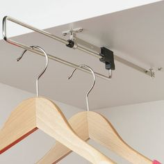 Pull out Wardrobe Rail for under stairs. You could have a few of these attached under the higher stairs and some storage boxes or even a chest of drawers underneath, then you could do away with the black frame and the room would look / be much larger. Eaves Storage, Loft Storage, Stair Storage, Bedroom Storage, Storage Boxes, Storage Rack, Diy Storage, Diy Bedroom, Hanging Clothes Rail