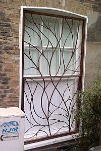 Decorative Window Bars - the next step. Just be sure they ...