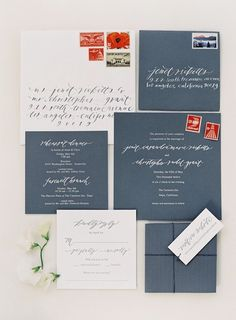 grey wedding invitations w/ white lettering. maybe a colored edge in my color scheme?