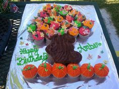 I made this for my nieces 6th birthday. Cupcakes are pumpkin chocolate chip, they were super yummy! Frosting is butter cream except the dark brown is store bought chocolate frosting. I found this neat 3 pack leaf cutter that also indents the leaves to have veins at a local cake supply store. It worked out very well. Thanks for looking!