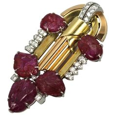 Art Deco 20.00 Carat Carved Ruby Diamond 18K Gold and Platinum Brooch | From a unique collection of vintage brooches at https://www.1stdibs.com/jewelry/brooches/brooches/