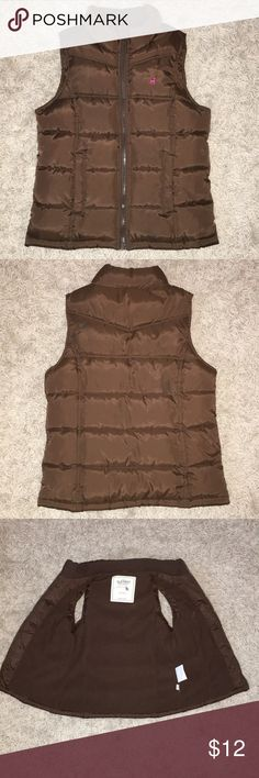Old Navy Girls Cute Puffy Dark Brown Vest w/Zipper Shell: 100% Polyester with Acrylic Coating, Lining/Filling: 100% Polyester Dark Brown Puffy Vest with Pink Logo and Pockets. Never been worn. My daughter outgrew this Vest so fast that she never even got the chance to wear it once. Old Navy Jackets & Coats Vests
