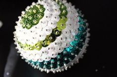 DIY Sequin Ornaments...my grandmother taught me how to make these as a little girl. They were so beautiful shimmering in the tree. This year she passed....I would love to teach my kids how to make their very own.