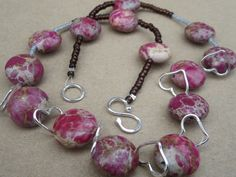 A personal favourite from my Etsy shop https://www.etsy.com/uk/listing/198696740/jasper-gemstone-necklace-pink-natural