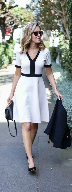black and white classic knit fit and flare dress, black tie neck jacket, scalloped ballet flats, black handbag + sunglasses {boden, m2malletier, wonderland}